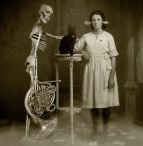 The Skeleton, the Cat, and the Girl